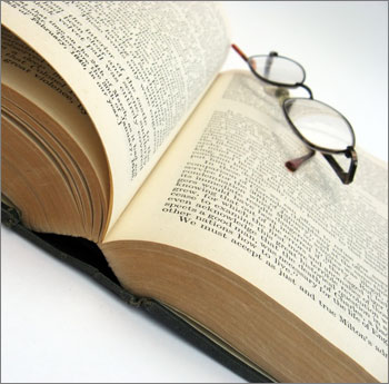 photo of a book and glasses
